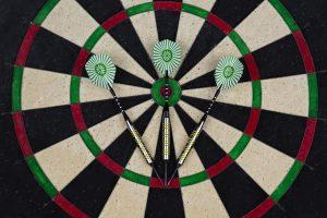 three darts on a dart board